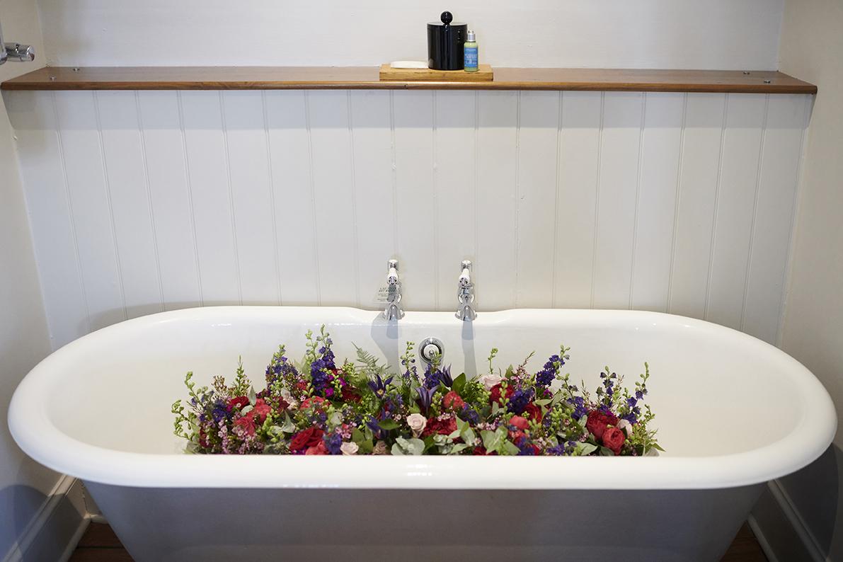 flower arrangement by see Rose floral design kent wedding hotel du vin