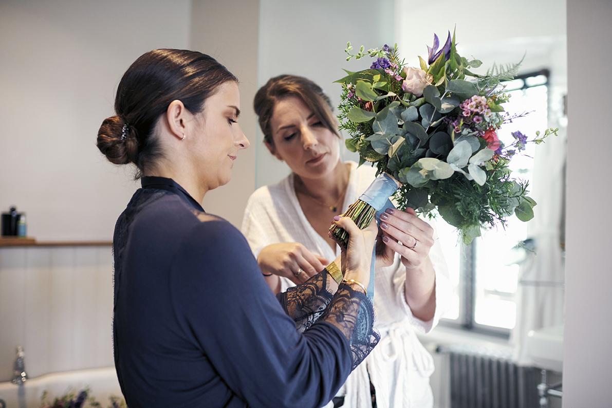 bridesmaids arrange bridal bouquet by see rose floral design hotel du vin kent