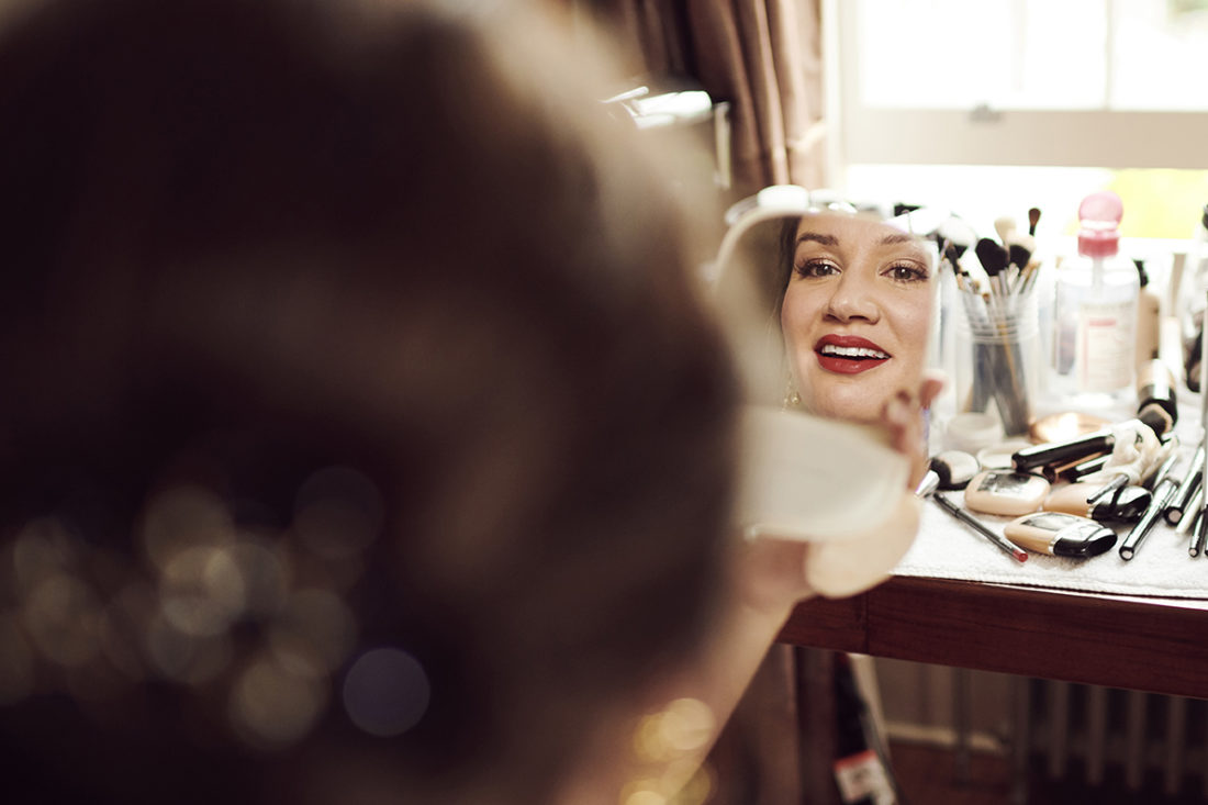 bride smiles with red lipstick at hotel du vin tunbridge wells Kent UK