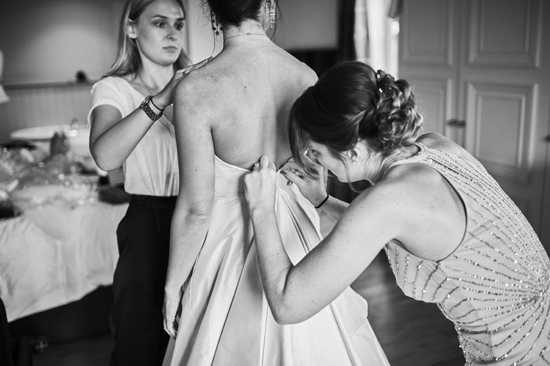 fitting the romona keveza silk dress wedding photographer kent