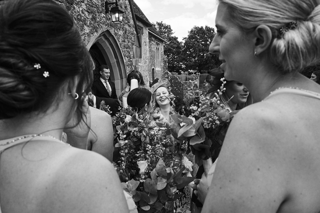 guests at wedding laughing and greeting each others luxury kent wedding UK