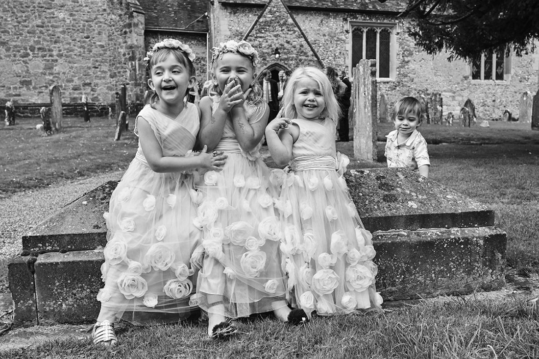 really cute flower girls wearing matching flower tulle dress
