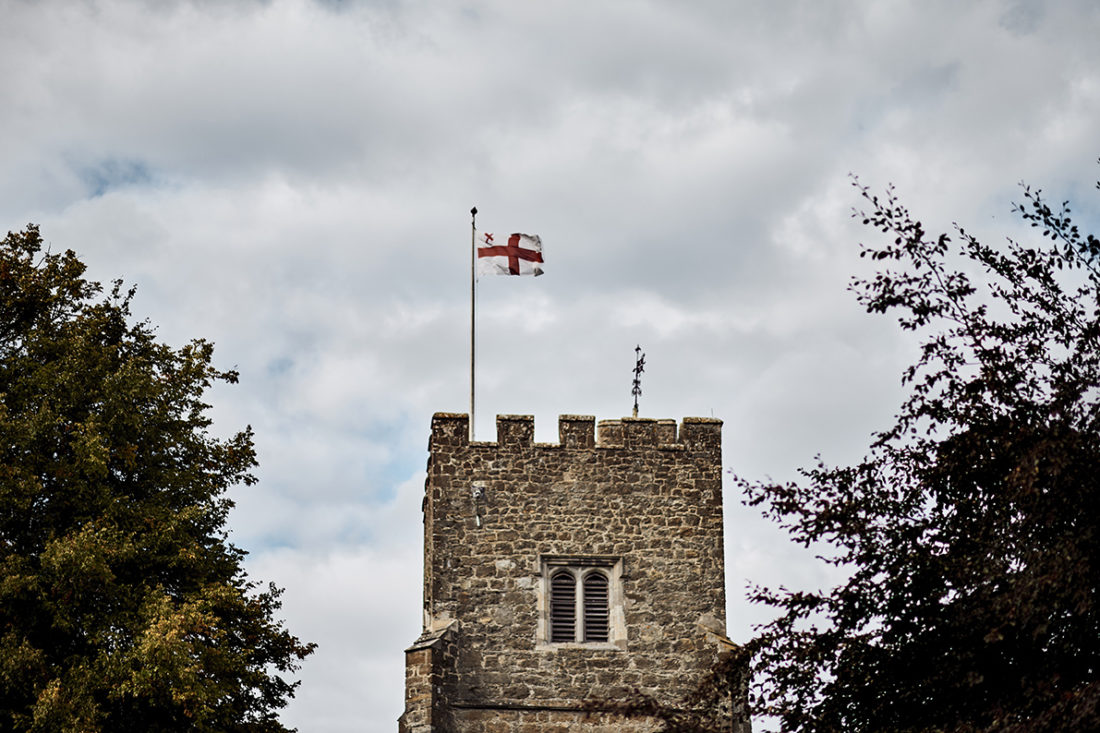 st george's flag over church wedding kent UK