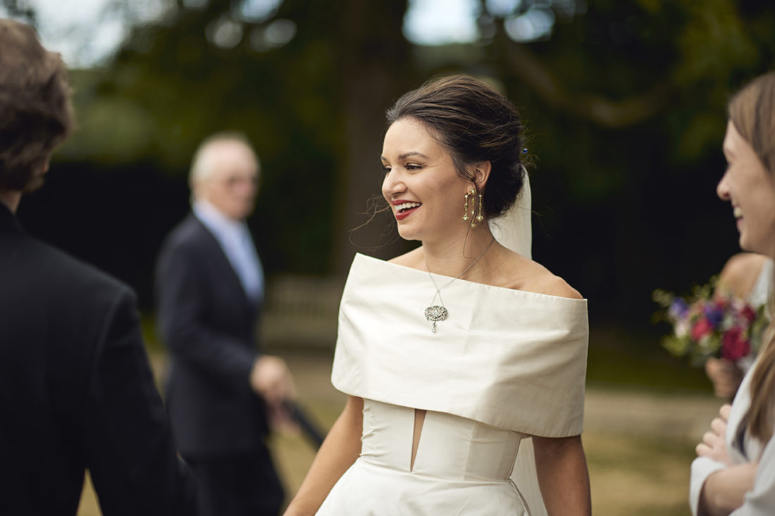 bride smiling in a romona keveza dress kent luxury wedding