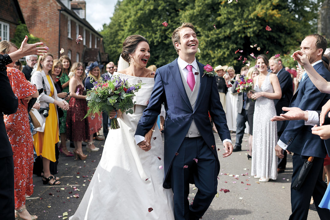 bride and groom looking really happy confetti throw kent wedding UK