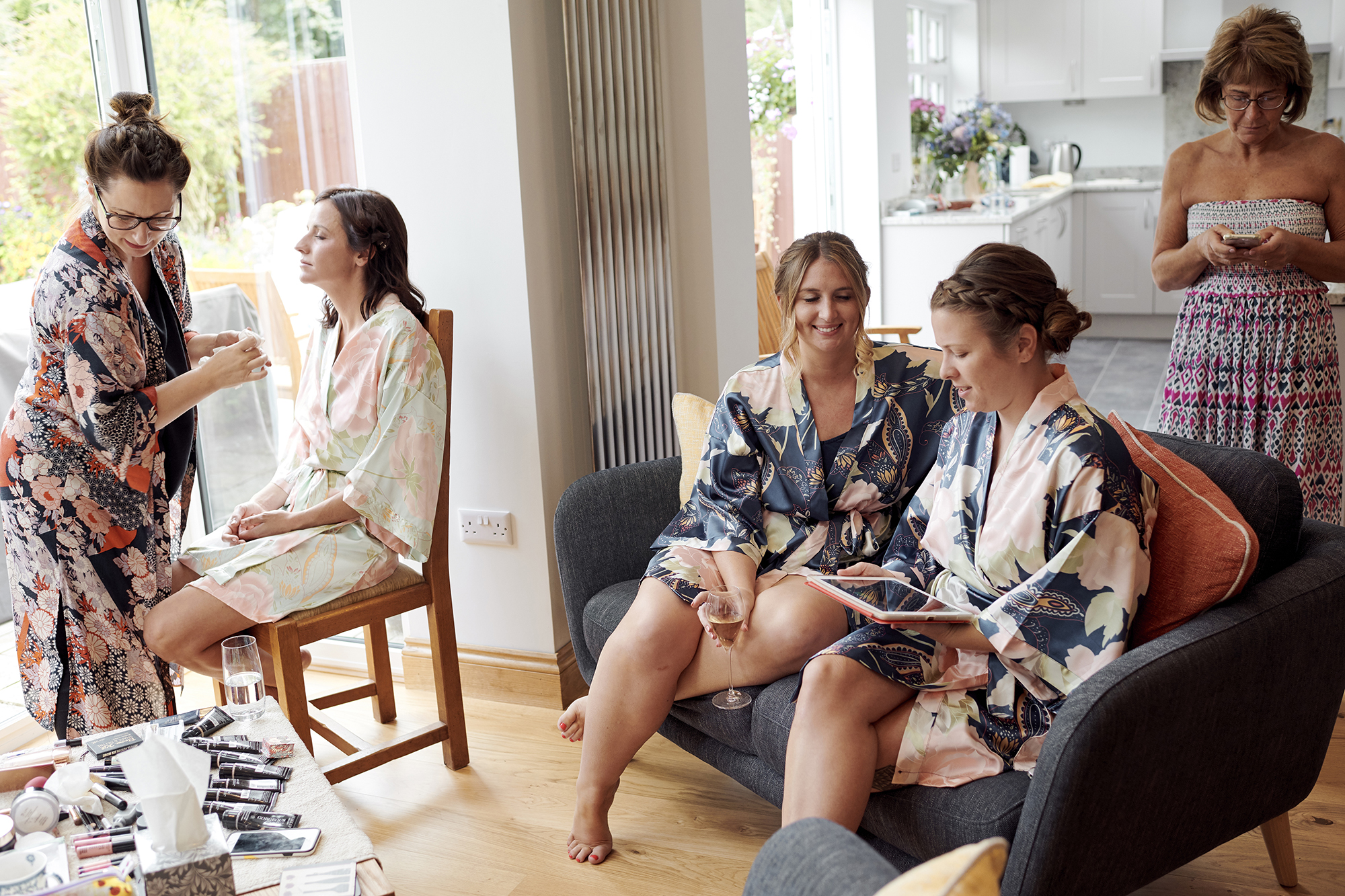 bridesmaids chatting whilst getting ready for a wedding in essex